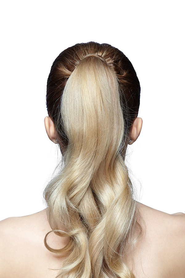 Woman with long hair in ponytail