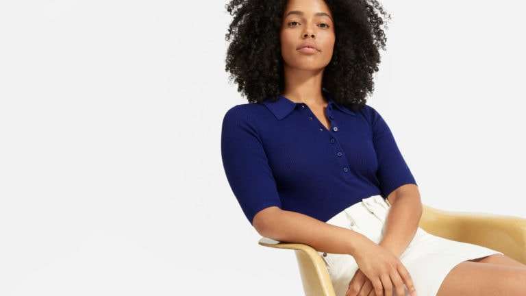 Woman wearing ribbed sweater by Everlane