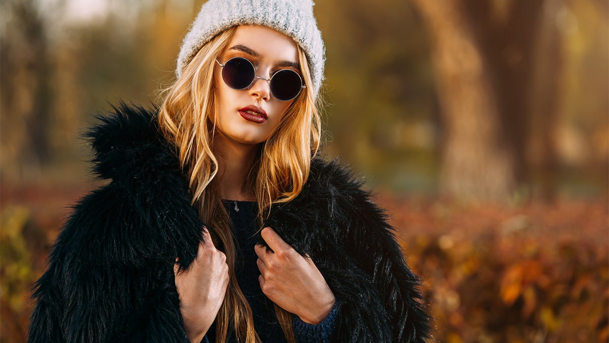 Woman wearing beanie and faux fur
