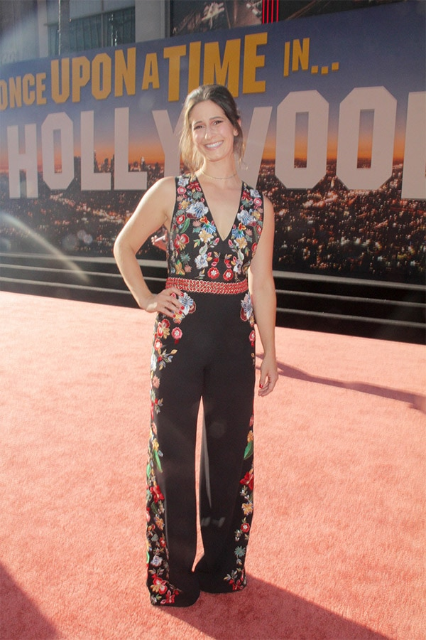 Breanna Wing wearing a floral jumpsuit at movie premiere
