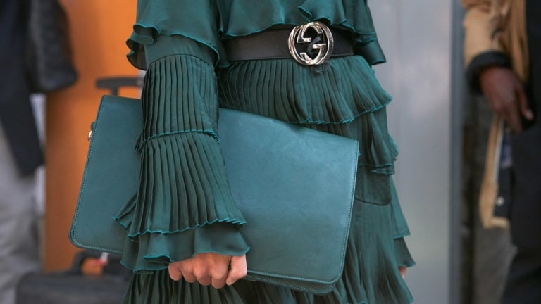 Woman wearing Gucci belt and trending color, forest green