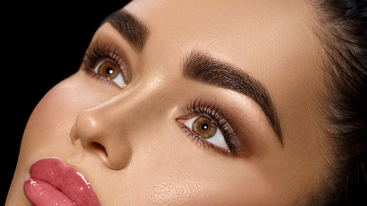 Closeup of woman with brown eyes and professional makeup
