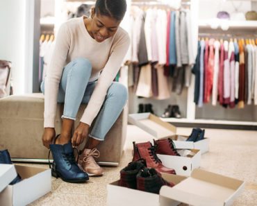 Woman trying on trending fall shoes