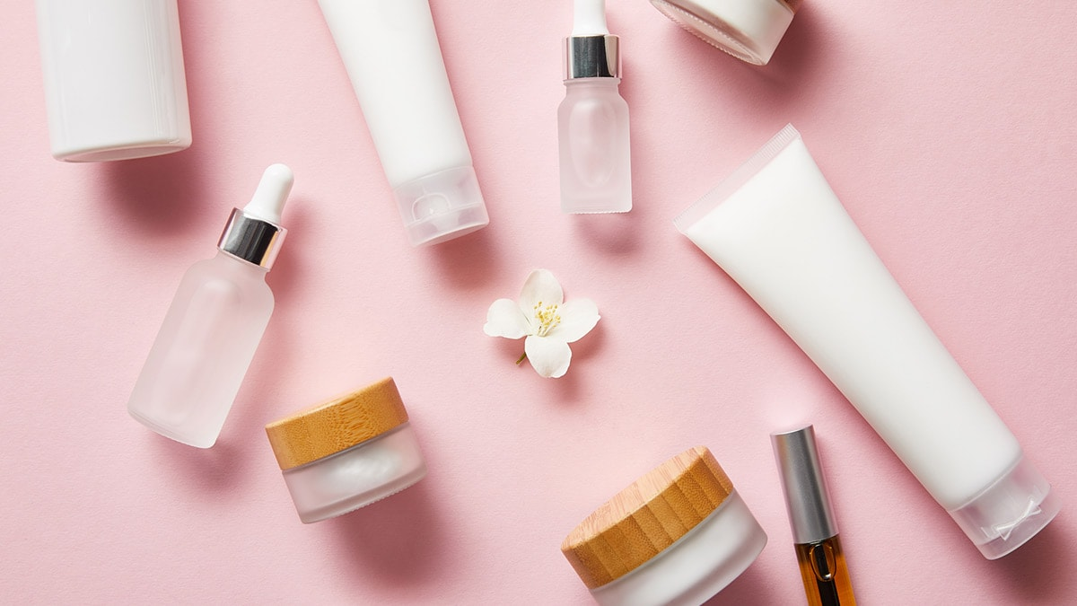 Beauty products on pink table