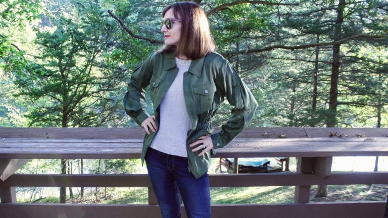 Catherine Brock wearing a military jacket rented from haverdash