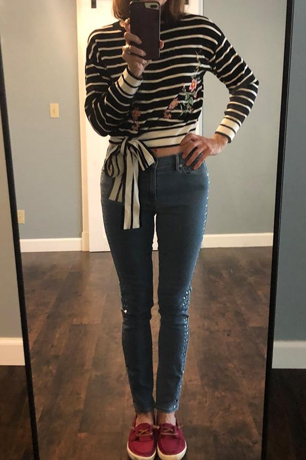 Catherine Brock wearing crop tie sweater