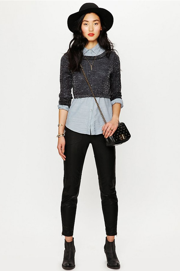Woman wearing cropped sweater with longer shirt beneath