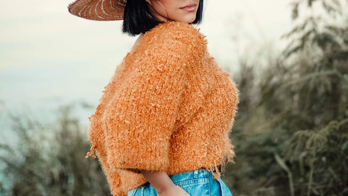 Woman wearing cropped sweater