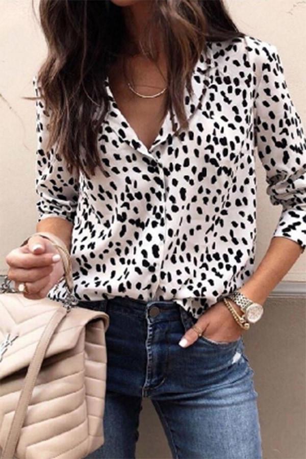 Woman wearing leopard print blouse