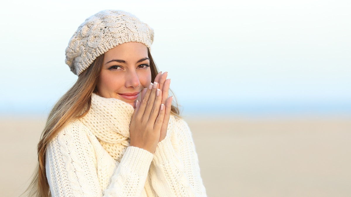woman wearing beanie and scarf in winter