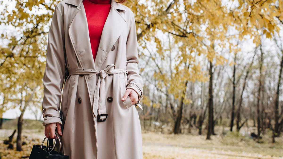Woman wearing trench coat outside