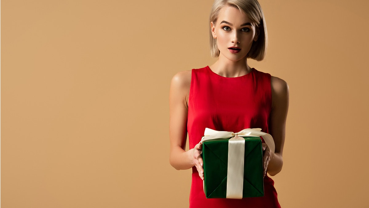 Fashionable woman holding gift