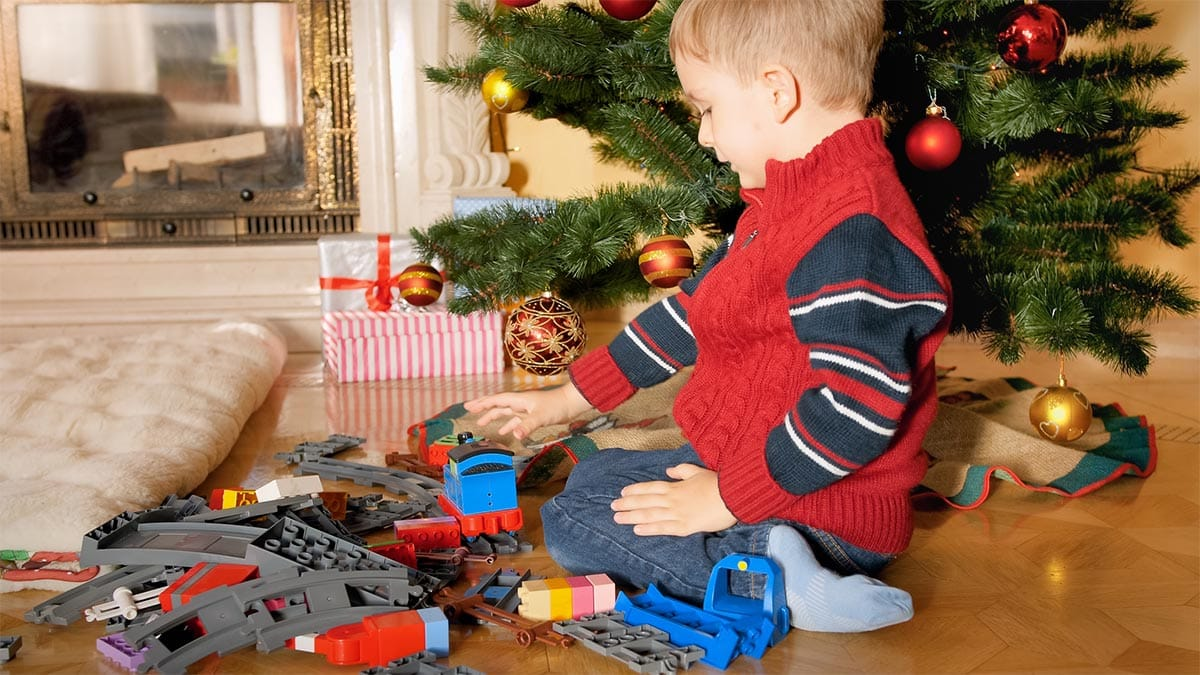 Toddler playing with holiday toys