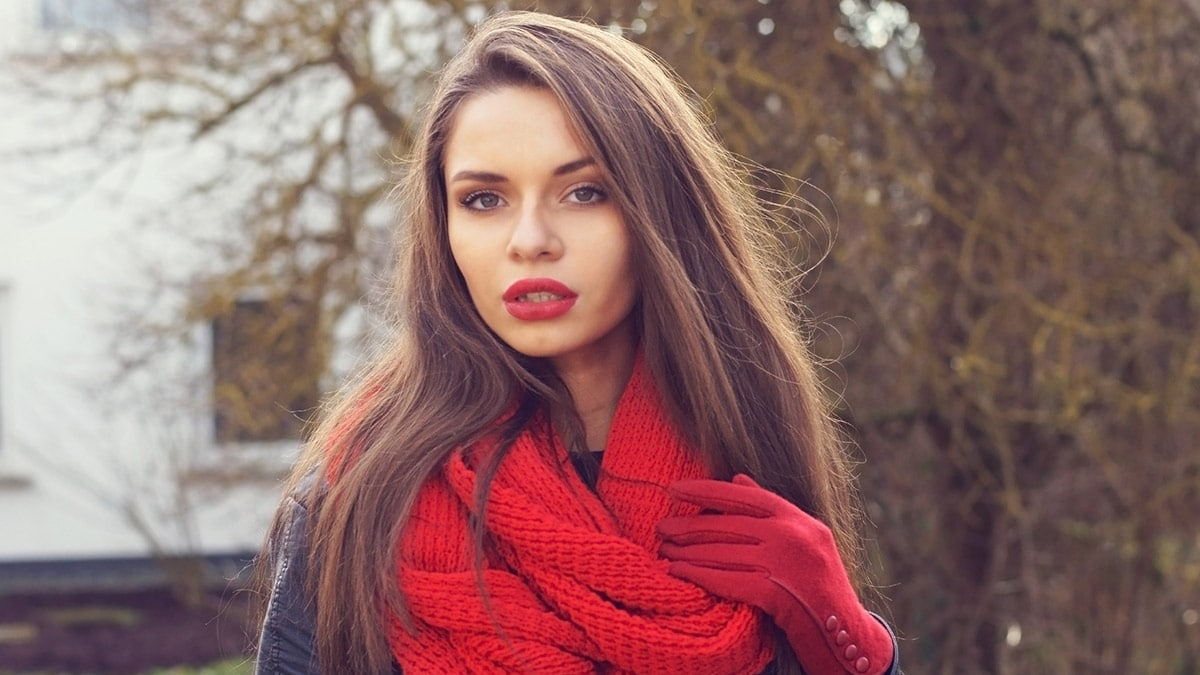 Woman wearing red winter scarf