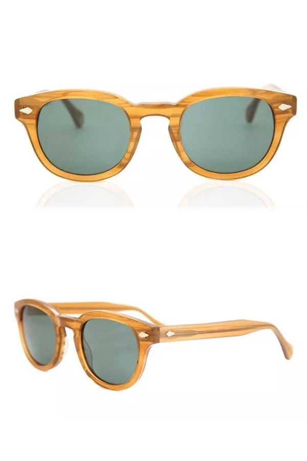 Sunglasses with acetate frames and green lenses