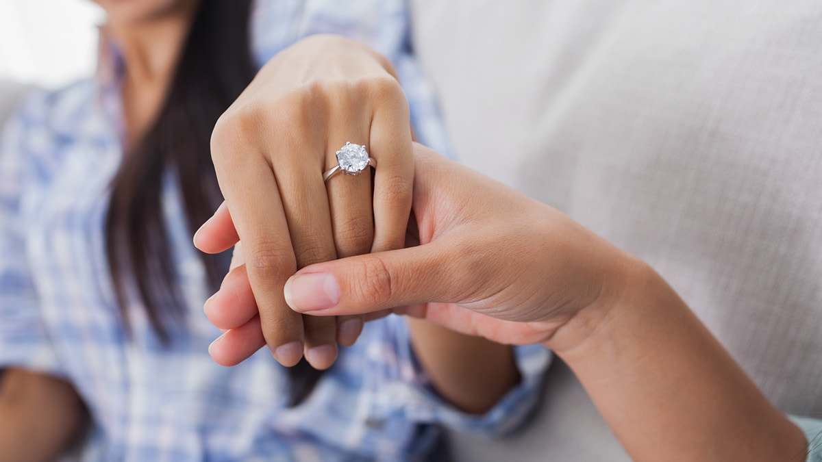 close up of woman's engagement ring