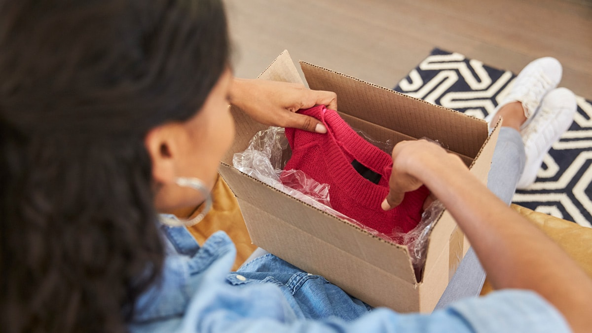 Woman opening a box of clothes
