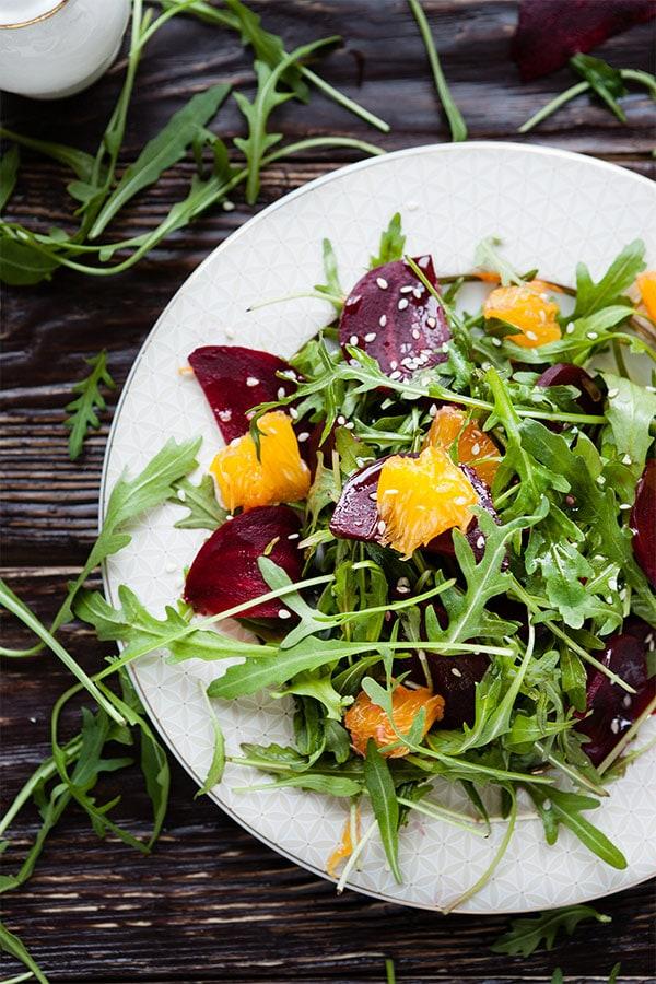 Plate of green arugula salad