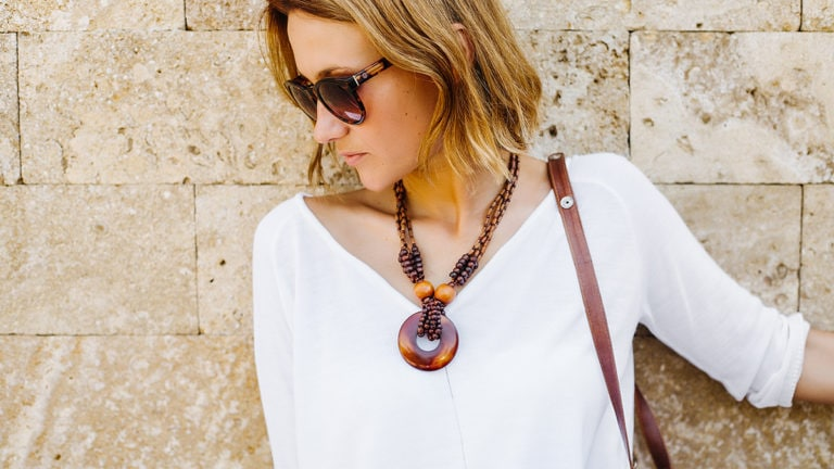 how to dress up casual outfits: woman wearing statement necklace