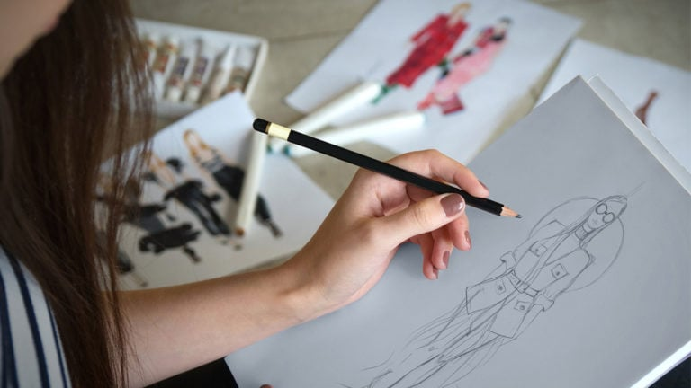 Woman sketching fashion