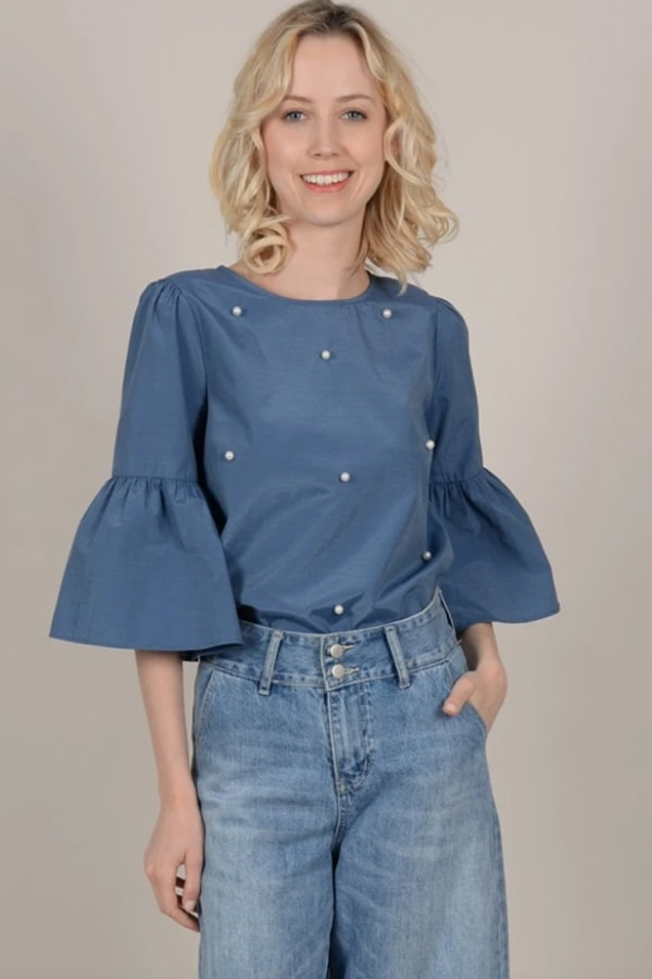 Blue pearl top from Winnie Cooper Boutique