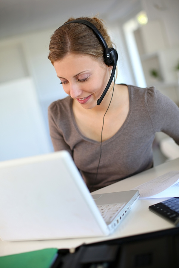 Woman on video call with coworkers