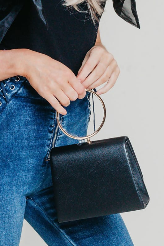Black mini bag with gold ring handle