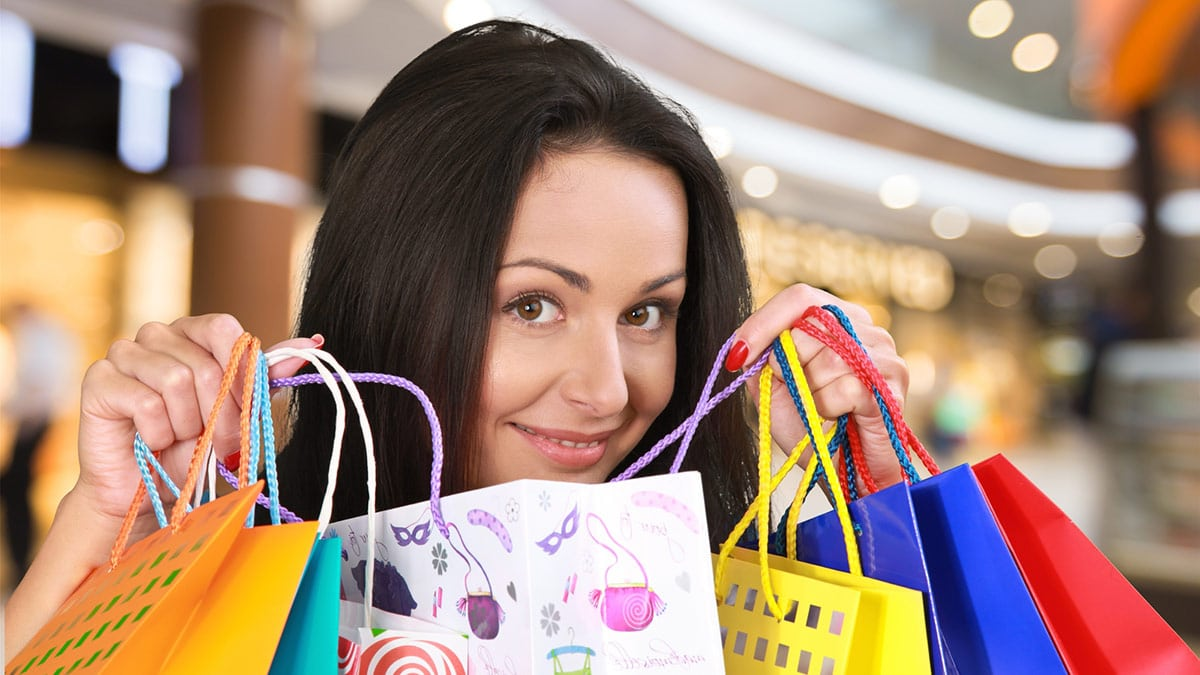 Woman with bags of fashion splurges