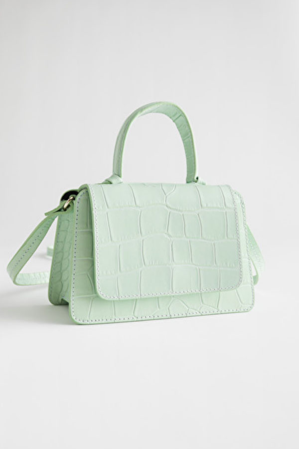 Mint green purse with crocodile texture
