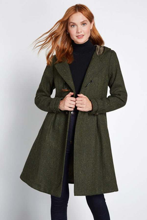 Woman wearing dark green coat from Modcloth