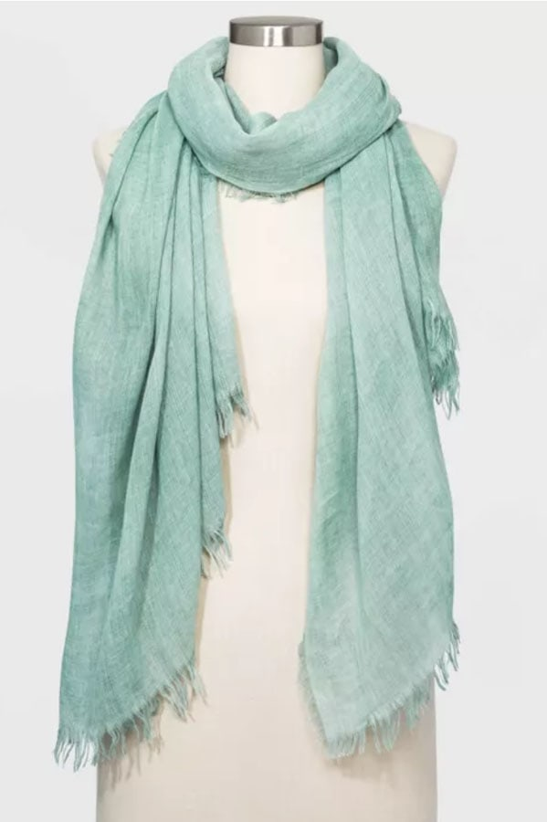 Green scarf with frayed edges