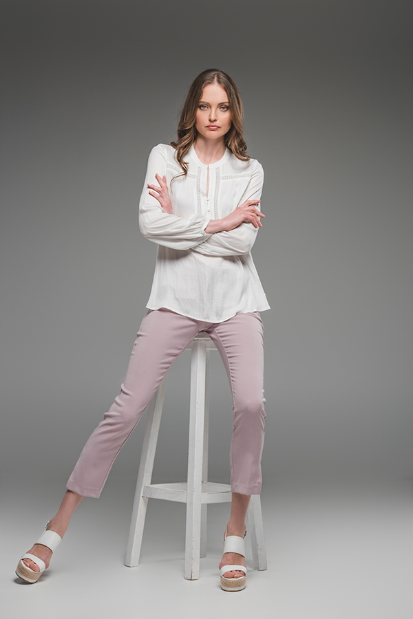 Budget fashion woman wearing blouse and pink denim pants with sandals