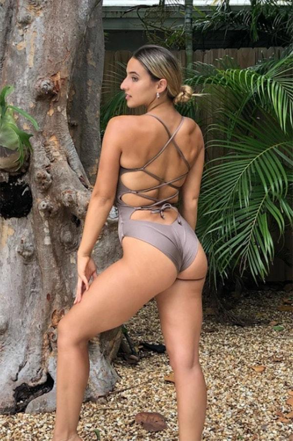 Woman wearing one-piece cheeky swimsuit