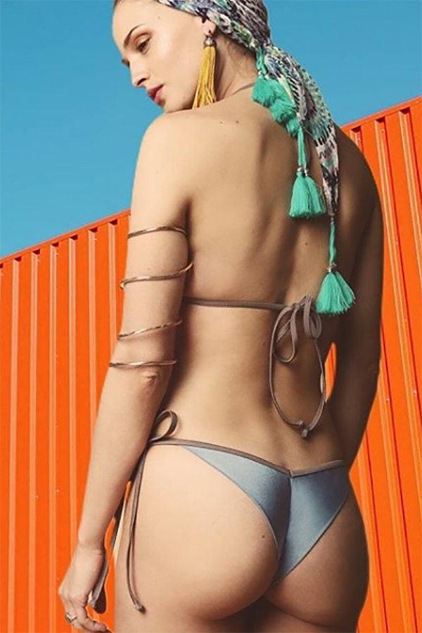 Woman wearing cheeky swimwear and jewelry
