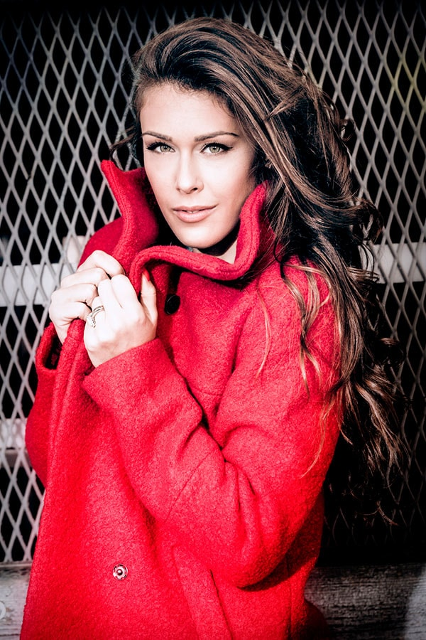 Woman wearing red textured coat