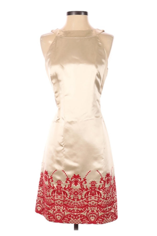 Ivory dress with red stitching