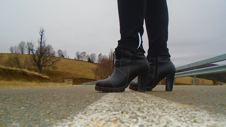 Close up of women's fashion boots in the road