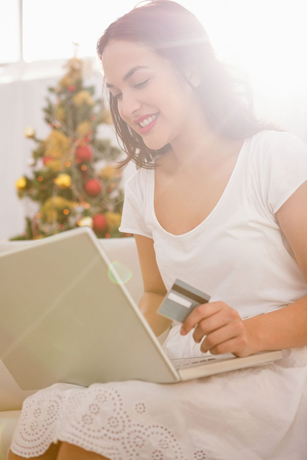 Brunette looking up the value of her gift card online.