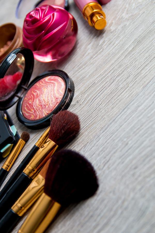 Collage of makeup and makeup brushes to represent makeup expiration dates.