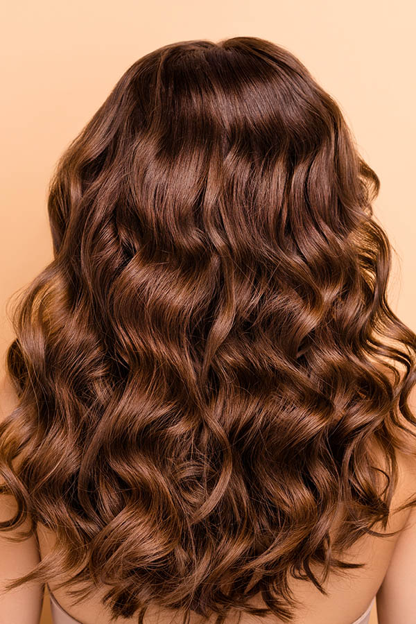 Close up of healthy curled hair from the back of the head.
