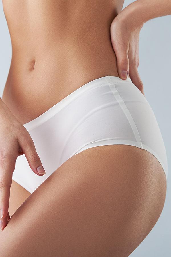 Close-up of woman wearing white hipster panties.