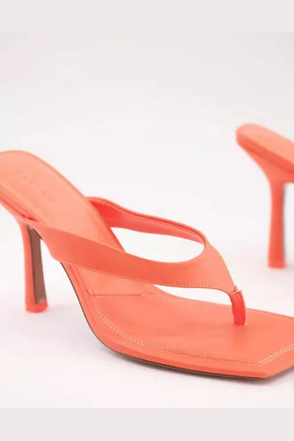 Orange neon heeled sandal.
