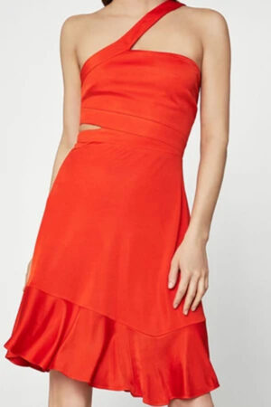 One-shoulder red dress with side cutout and flounce hemline.