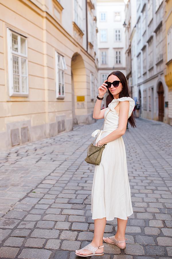 Woman tourist wearing sunglasses and dress.