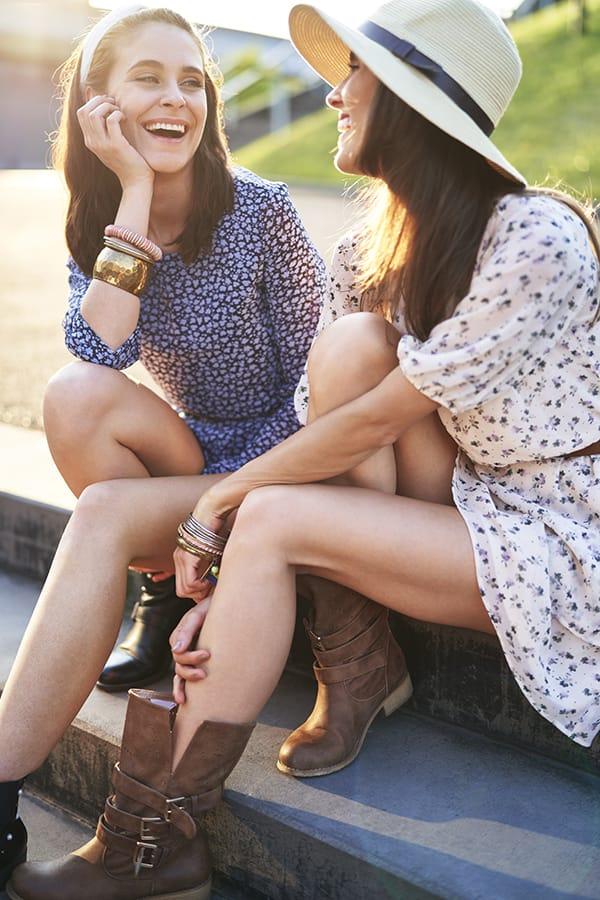Two women wearing bangles.