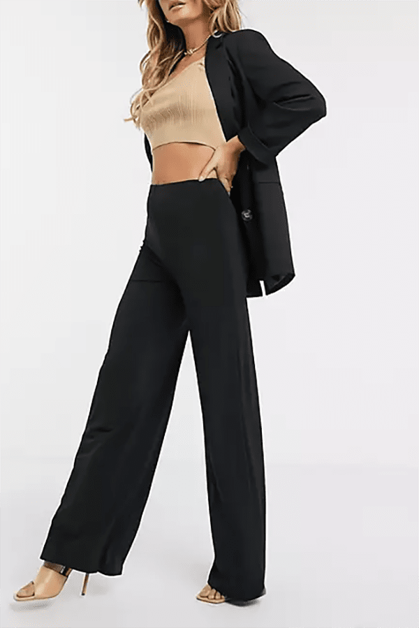 Black high-waisted pants for the woman with a long torso.