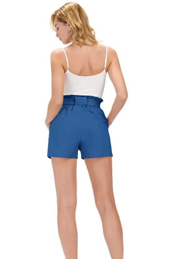 Rear view of woman wearing high-waisted shorts.
